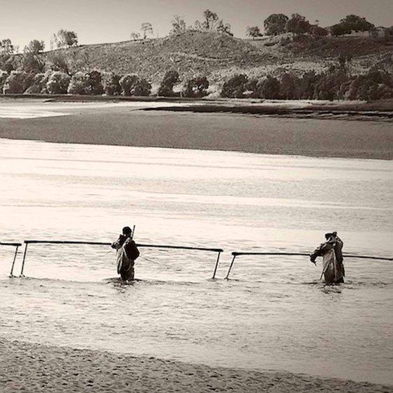 Local half netter fishermen waiting on the tide